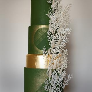Green and gold geometric wedding cake with dried foliage