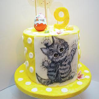 Birthday cake with hand-painted kitten