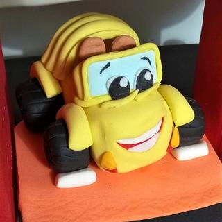 Yellow cabriolet cake topper.