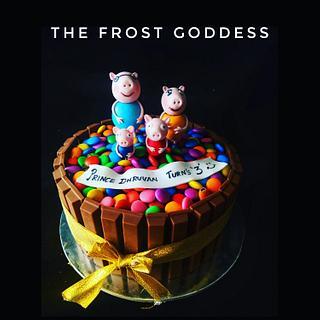 A KitKat and gems peppa pig cake  - Cake by thefrostgoddess