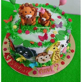 A Cute Jungle theme cake with Simba and animals on it