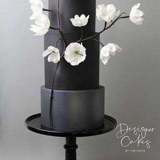 Shades of black with dogwoods - Cake by Designer Cakes By Timilehin