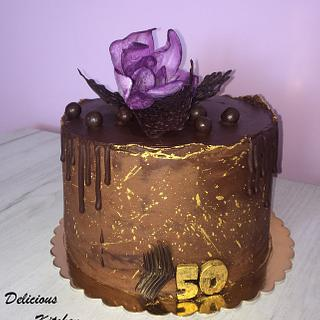 Chocolate cake with wafer paper magnolia