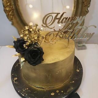 Gold black cake