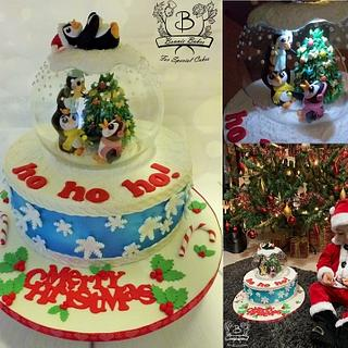 Snow globe Christmas cake with penguins
