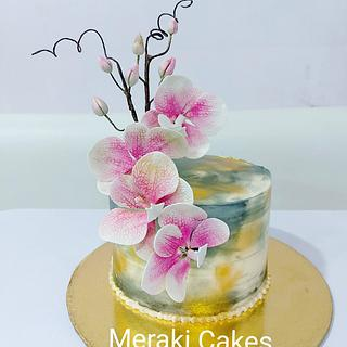 Sugar Orchids on a buttercream cake
