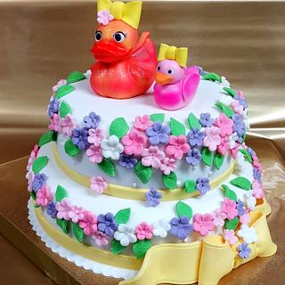 Cake with ducks and flowers