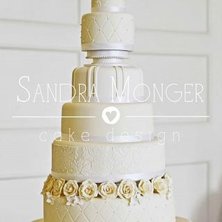 7 tier ivory and white wedding cake.