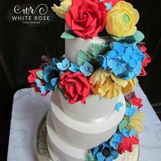 Brights Floral Cascade Wedding Cake for Superhero Themed Wedding :)