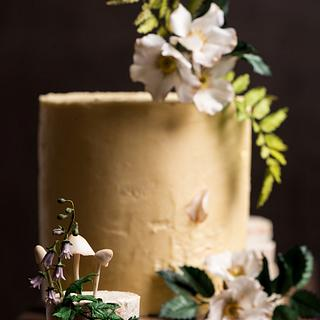 Rustic woodland cake with sugar flowers