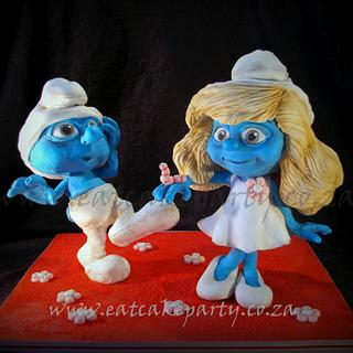 Clumsy and Smurfette 3D cakes