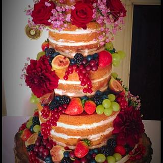 Berries and fresh flowers naked cake!