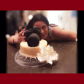 Camara cake and a girly lady