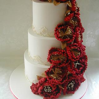 Red, white and gold wedding cake