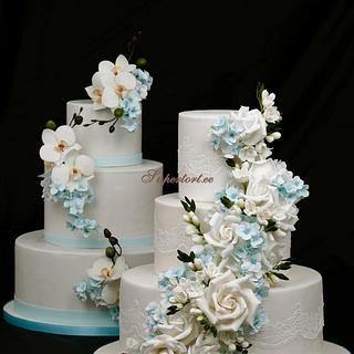 2 cakes with sky blue flowers