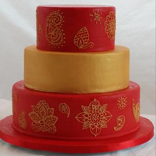 Red and gold mehndi wedding cake