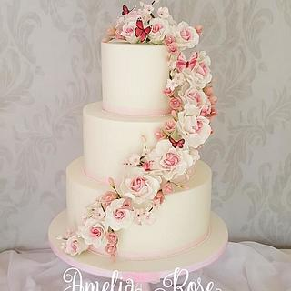 Pink rose and butterfly cascade wedding cake