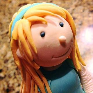 Gumpaste girl figure.