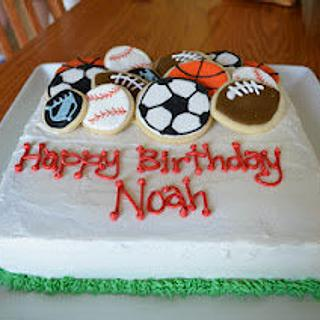 Sports theme birthday cake with cookie toppers - Cake by bakedbyrachel