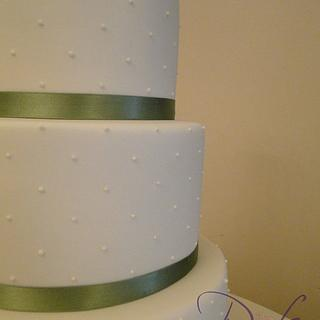 Piped swiss dots wedding cake