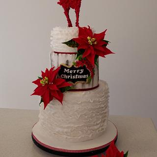 Christmas cake with poinsettias and a reindeer ...