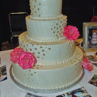 Coral and gold wedding cake in Buttercream