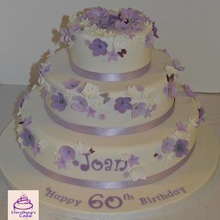 3 tier purple and lilac flowers