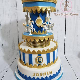 Gold and royal blue carousel cake - Cake by Nora Brown Cakes
