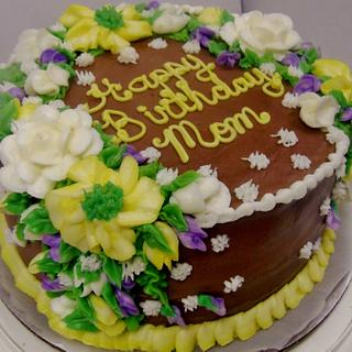 Layer chocolate buttercream cake in floral design