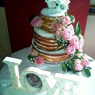 Naked pink roses wedding cake