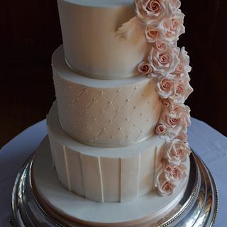 Elegant wedding cake with cascading roses