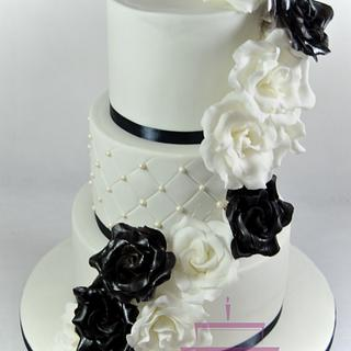 Wedding cake with black and white roses