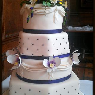 4 tiered Wedding Cake, with hand made flowers