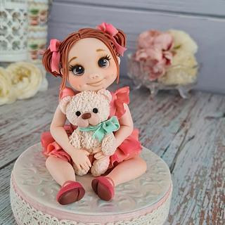 Girl with a teddy