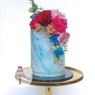 Blue marble cake with fresh flowers