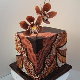 Beaded cake with chocolate cymbidium orchids