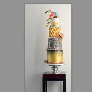 Gold cake with origami and flowers
