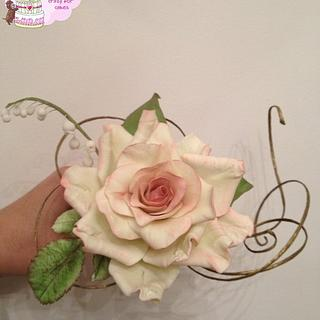 Rose with foliage and lily of the valley