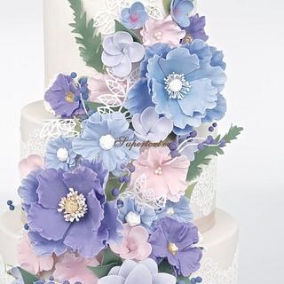 4 tiers wedding cake in pastel tones