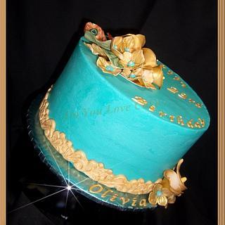 Teal/Gold Buttercream B-day Cake w/sugar calla lilies, hydrangeas & peacock feathers.