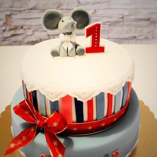 striped birthday cake with an elephant