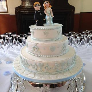 wedding cake with custom bride and groom topper