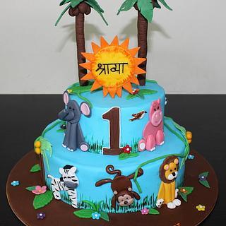 Jungle Animals theme 2 tier fondant cake for girls 1st birthday