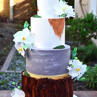 Orchid tree stump and moss wedding cake