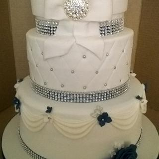 White wedding cake with bling and some Royal Blue touches
