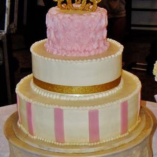 Pink rosette and stripe wedding cake