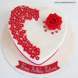 Heart shaped cake with roses for fiances birthday