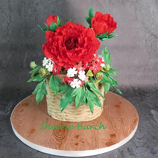 Red Peony in raffia basket