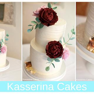 2 tier buttercream cake with sugarpaste flowers and naughty pup