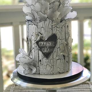 Olive + Oak cake with wafer paper hearts and crackle effect